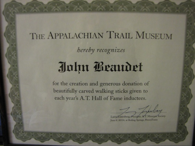 Certificate honoring John's contributions.