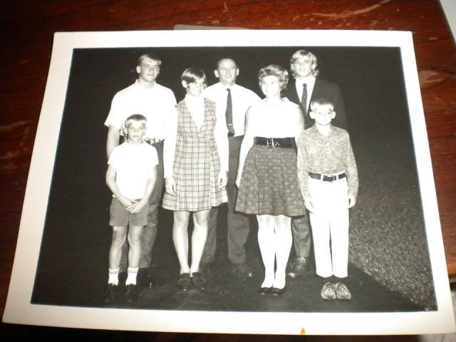 John is at bottom left, behind him Al, then Mary, his dad and mom, and Art standing behind Eddie.